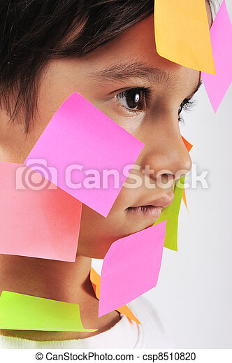 Little boy with memo notes on his face - csp8510820