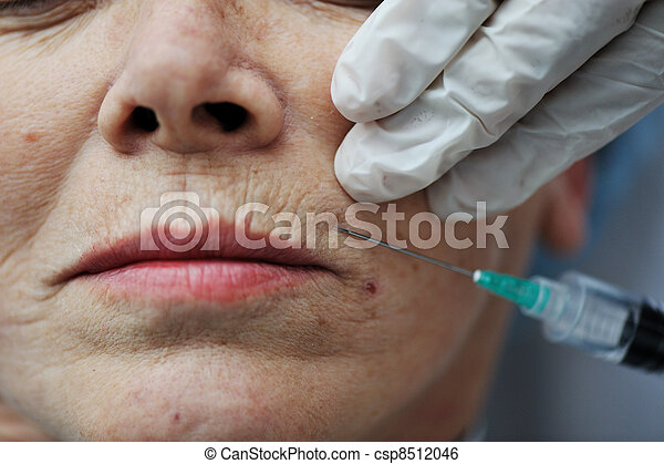 Senior woman getting skin care injection  - csp8512046