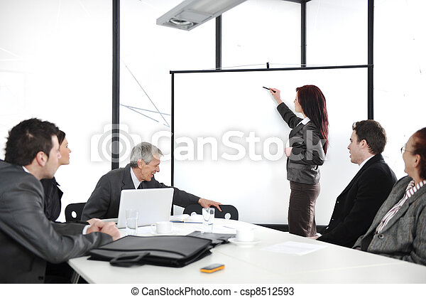 Business woman drawing a graph on whiteboard during the presentation at office - csp8512593