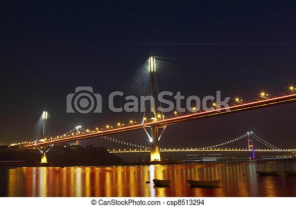 Ting Kau Bridge in Hong Kong at night - csp8513294
