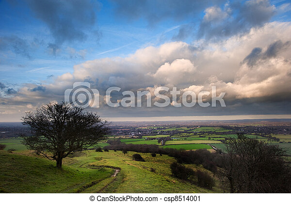Stunning cloud formations during stormy sky over countryside landscape with vibrant colors - csp8514001