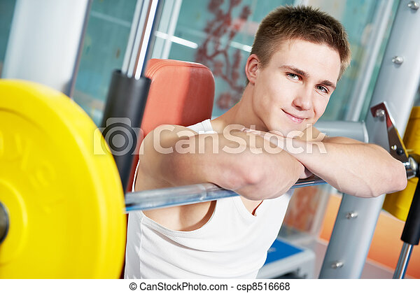 bodybuilder man doing muscle exercises with weight - csp8516668