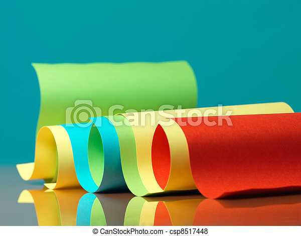 curved, colorful sheets of paper with reflexions - csp8517448