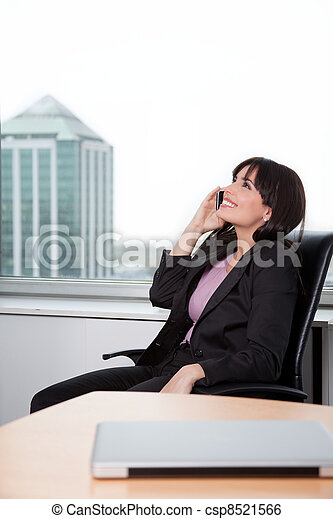 Business Woman Talking on Cell Phone - csp8521566