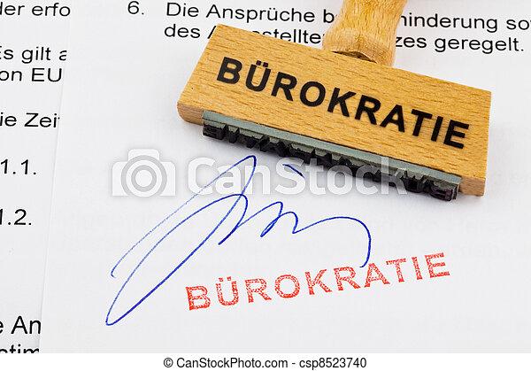 wooden stamp on the document: bureaucracy - csp8523740
