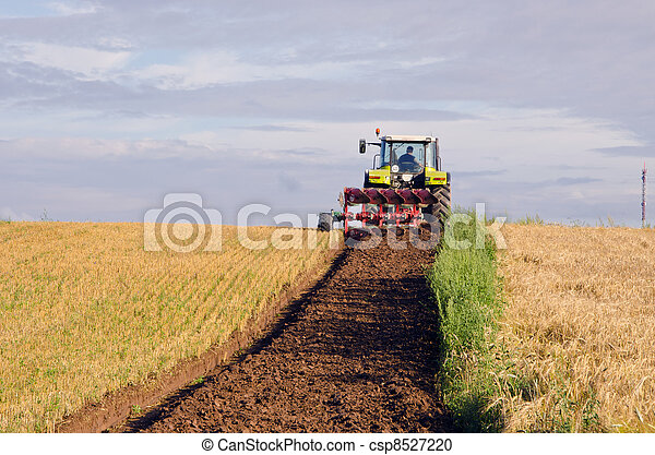 Tractor plow agricultural field harvested land  - csp8527220