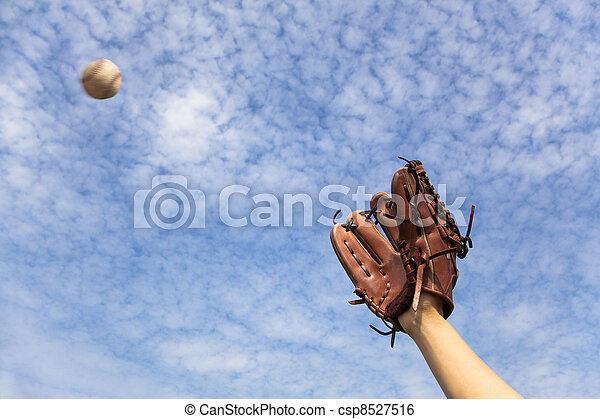 hand in baseball glove and ready to  catching the ball - csp8527516