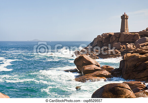 lighthouse in the rocks on Brittany Pink Granite Coast in France - csp8529557