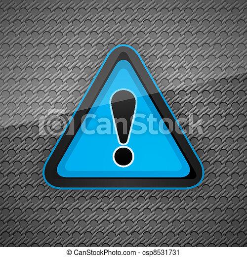 Hazard warning attention symbol on a dark gray metal surface - csp8531731