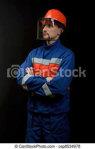 The worker in overalls and a helmet - csp8534978