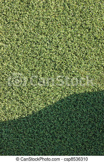 Artificial grass fake turf synthetic lawn field macro closeup - csp8536310