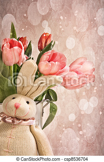Stuffed rabbit with tulips for easter - csp8536704
