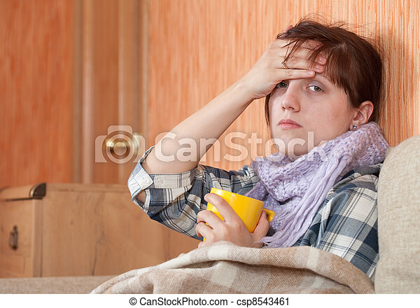 illness woman drinking hot tea - csp8543461