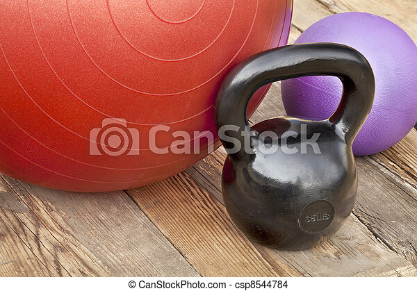 kettlebell and exercise balls - csp8544784