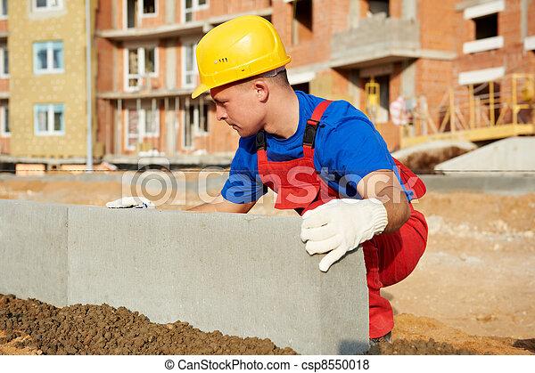 builder installing road concrete kerb - csp8550018