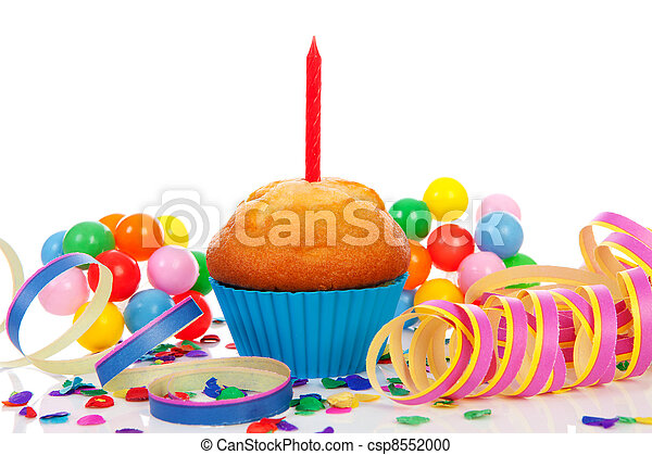 Birthday cupcake with candle, party streamers and colorful confetti over white background - csp8552000