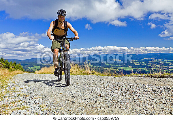 Mountain biker riding a bike - csp8559759