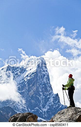 Woman hiking in Himalaya Mountains - csp8560411