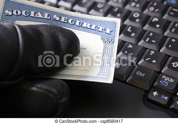 Identity theft and Social Security card - csp8560417