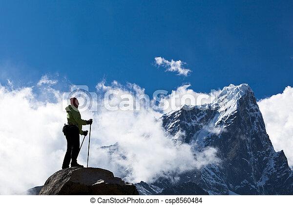 Woman hiking in Himalaya Mountains - csp8560484