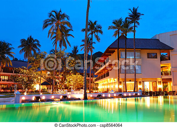 Green swimming pool near open-air restaurant in night illumination, Koh Chang island, Thailand - csp8564064