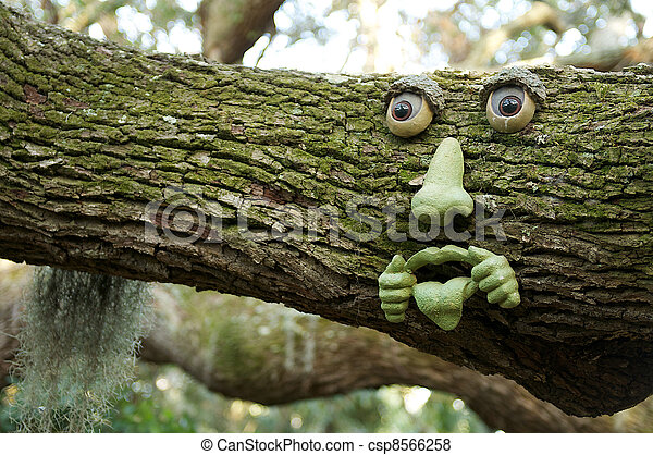 Pictures Of Garden Art Face On A Tree Branch Csp8566258