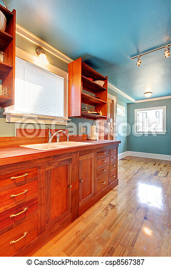 Custom build cherry kitchen with blue walls - csp8567387