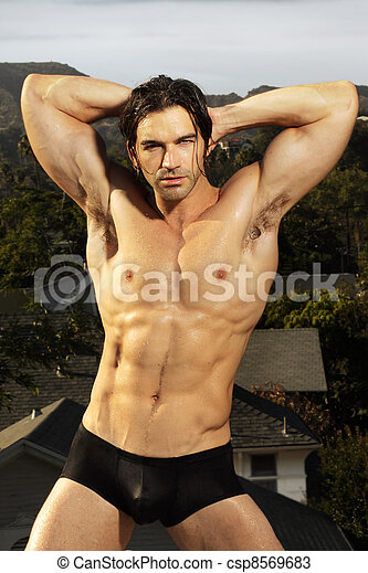 Bodybuilder posing - csp8569683