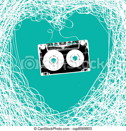 Old stereo audiocassette with tangled heart shaped magnetic tape. - csp8569803
