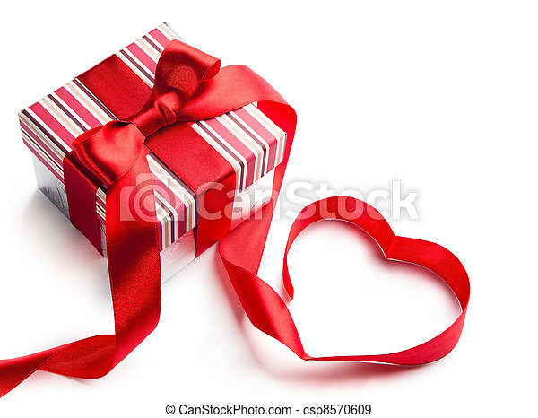 holiday gift box with red ribbon in the shape of a heart isolated on white background - csp8570609