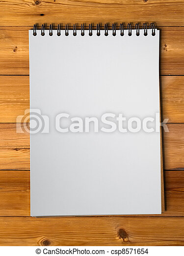 White sketch book on wood - csp8571654
