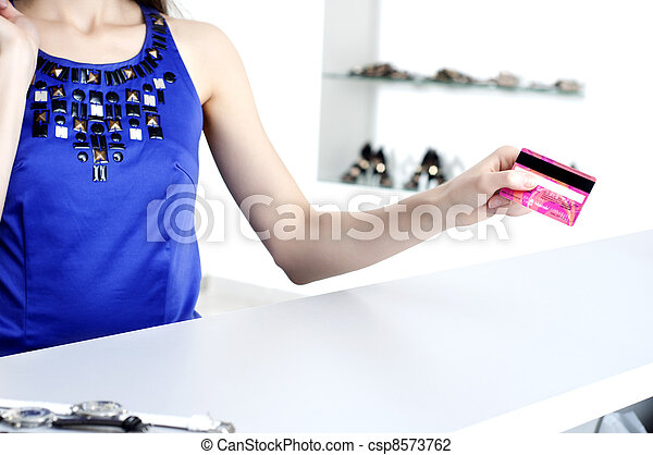 woman at shopping checkout paying credit card - csp8573762