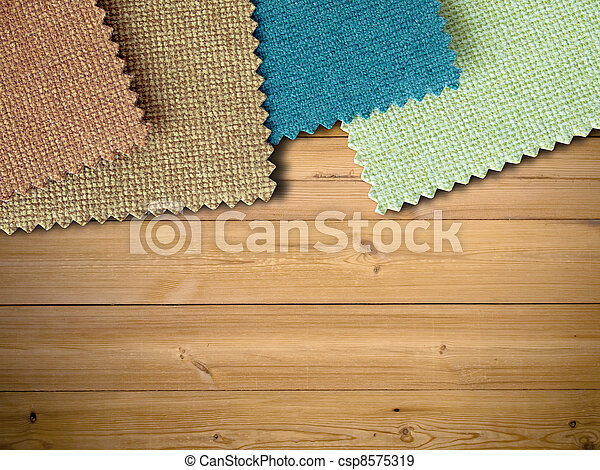 Fabric sample color on wood table - csp8575319