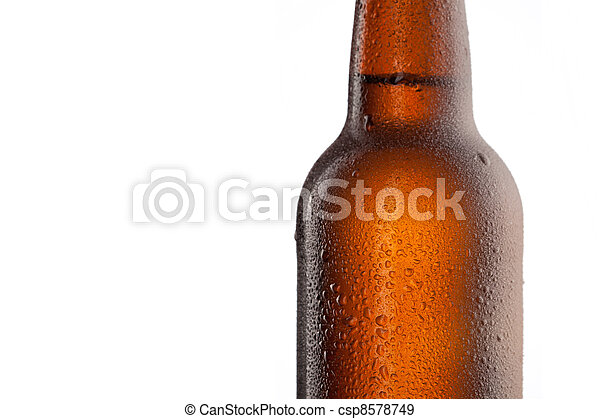 Beer bottle with water drops and frost isolated on white - csp8578749