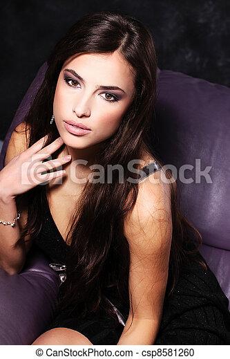 woman in frock on sofa - csp8581260