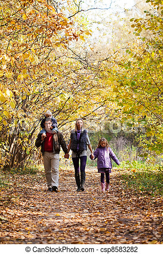 Family Enjoying Walk In Park - csp8583282