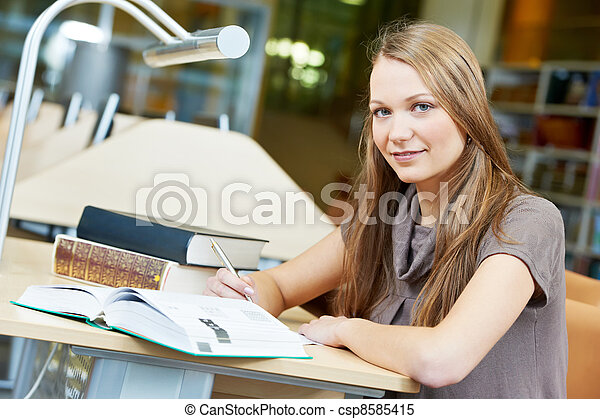 young student girl working with book at library - csp8585415