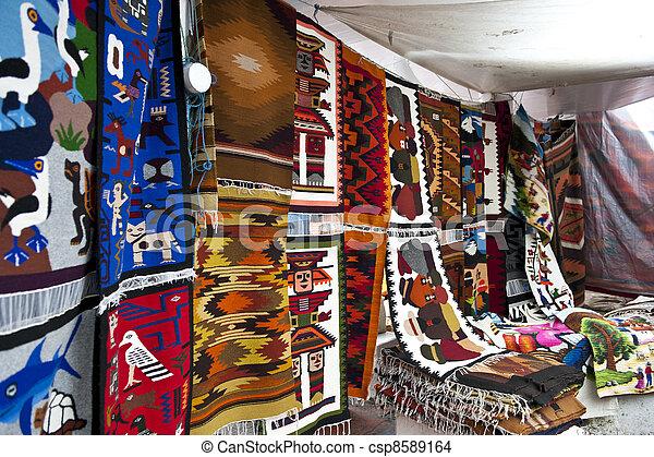 colorful indigenous market of Otavalo - csp8589164