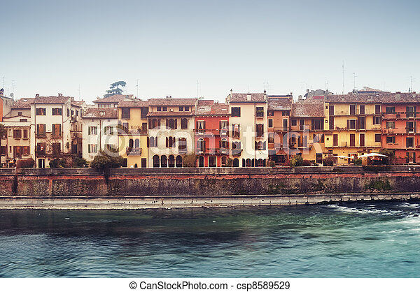 Typical Italian townhouses in Verona`s Old Town. `In 2000 Verona was listed as a World Heritage site by the UNESCO Committee, being an example of an Italian city that in its urban structure and archit - csp8589529