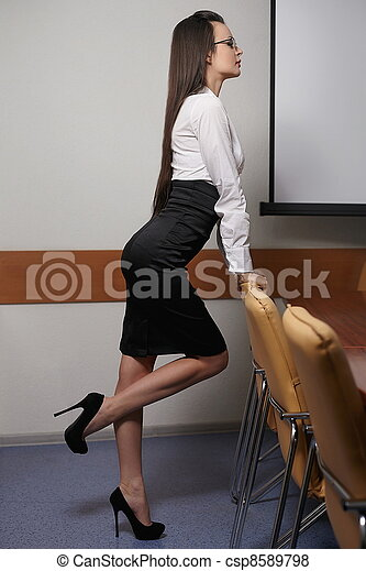 pictures of portrait of young sexy business woman in an office with csp8589798 search stock. Black Bedroom Furniture Sets. Home Design Ideas