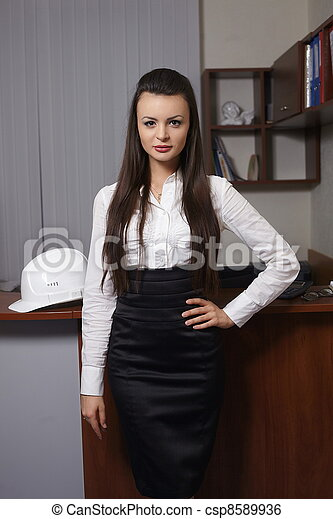 Portrait of a cute young business woman in an office environment - csp8589936