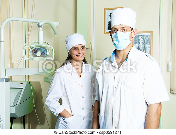 dentist and assistant in the office - csp8591271