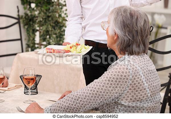 Waiter serving an entree - csp8594952