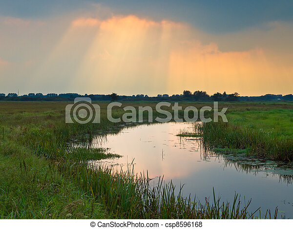 Sunrays are breaking through the clouds - csp8596168