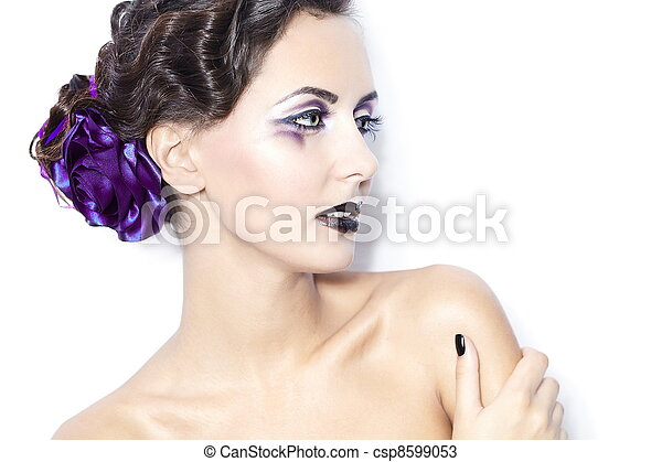 Beauty and health, cosmetics and makeup. Portrait of fashion woman model with bright purple  makeup, curly hairstyle on light white background. - csp8599053