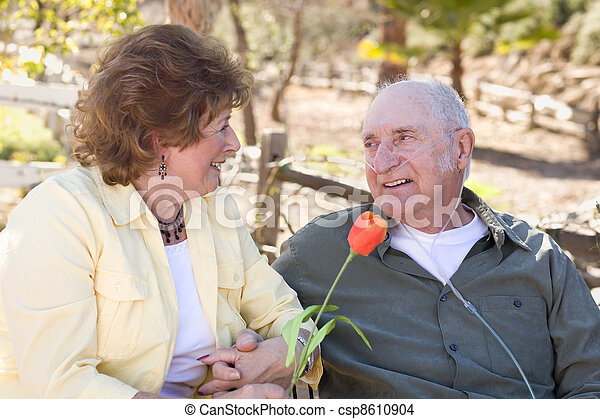 Senior Woman with Man Wearing Oxygen Tubes - csp8610904