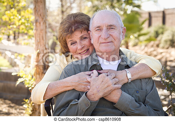 Happy Senior Couple Relaxing in The Park - csp8610908