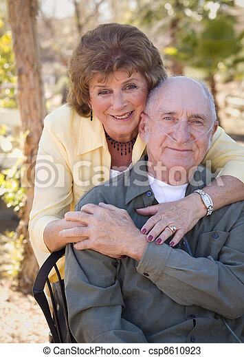 Senior Woman with Man Wearing Oxygen Tubes - csp8610923