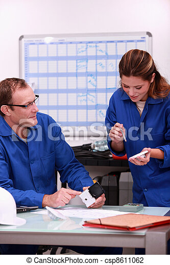 Two electrical workers ordering replacement part - csp8611062