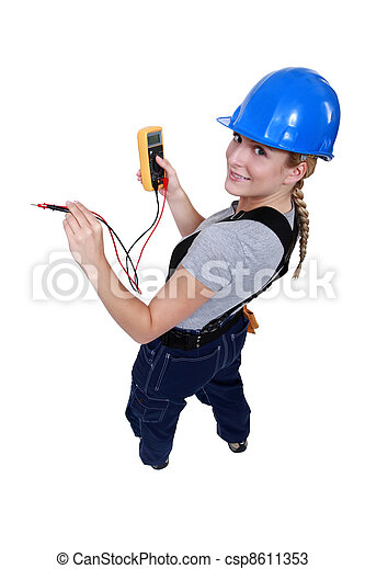 Female electrician with a voltmeter - csp8611353